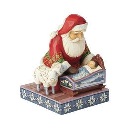 Santa kneeling with baby